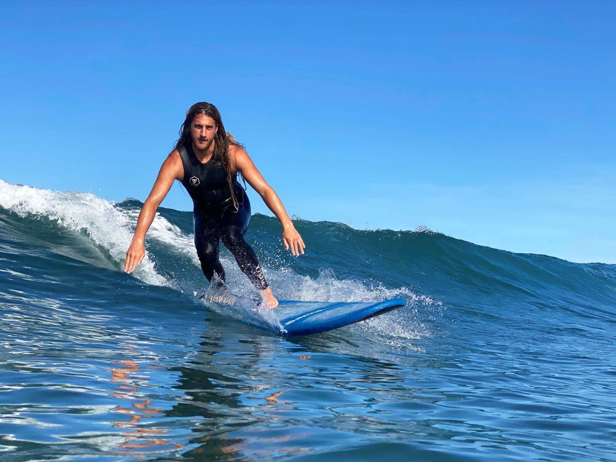 guided-surf-trip-man-enjoying-a-wave-surf-camp-las-palmas